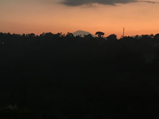 On a good morning at dawn, Mt. Agung peeks out from his hiding place! At our house, morning is full of anticipations. It is never the same, it is always special!