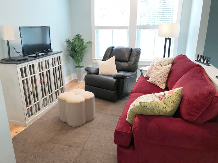Relax in the living room in comfy recliner or couch.