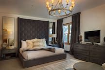 Spacious master bedroom with a king bed
