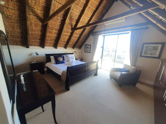 Room 1/Main room - Sleeps 2 on a king size bed with en-suite and sliding doors leading onto a patio