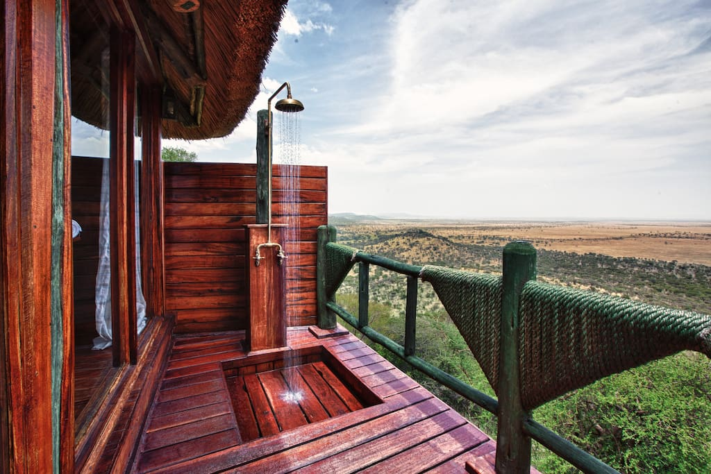 Outdoor shower with views of the Musabi and Nyamuma Plains