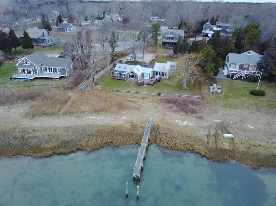 Bird's eye view of home with dock.