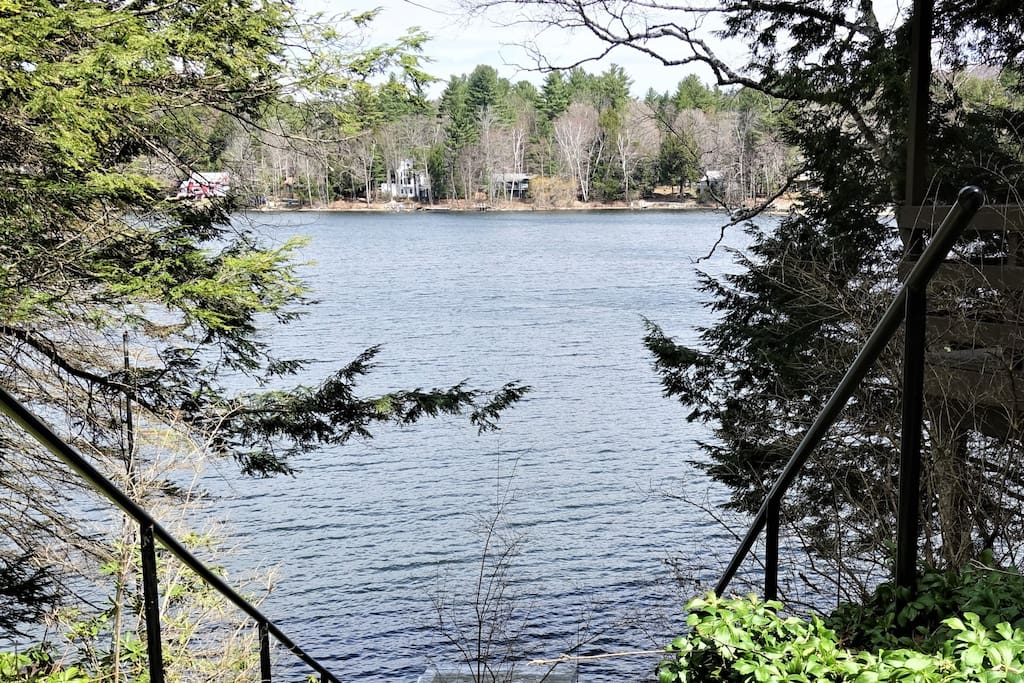 Lake view from top of steps down to first dock, walk in sandy bottom swim area