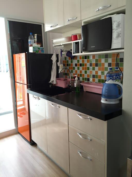 Kitchen with microwave fridge
