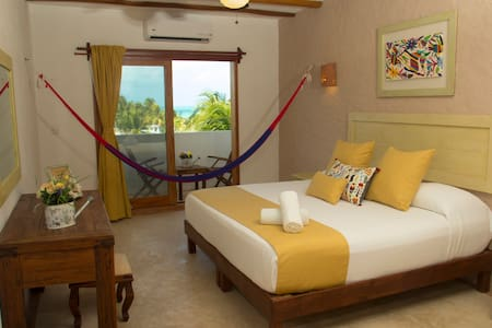 Ocean View Suite. King size bed or two queen beds. Hammock and some rooms have balcony.