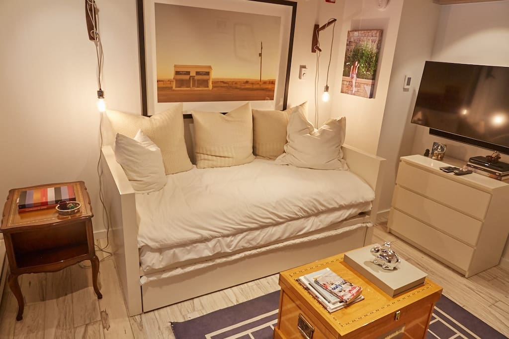 A twin-size bed plus twin trundle sleeps 2 in the main space.
