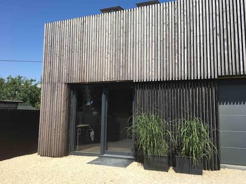 Larch clad architect designed contemporary annexe.