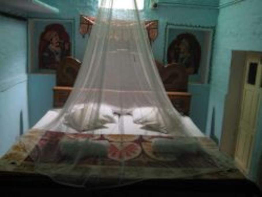 Room with the mosquito net