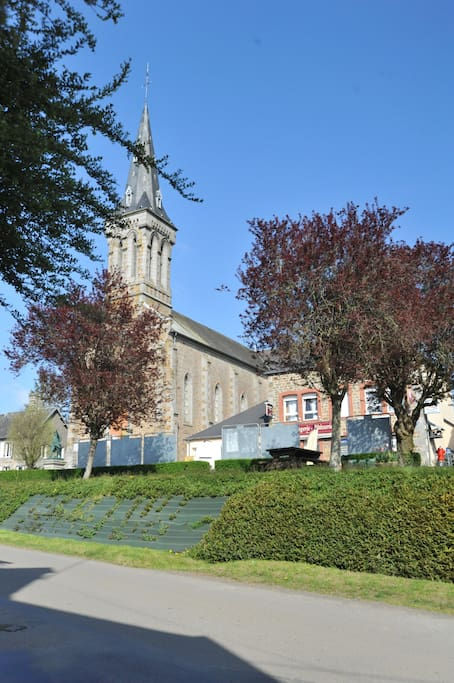 View of the village square which includes the village shop and church opposite the house