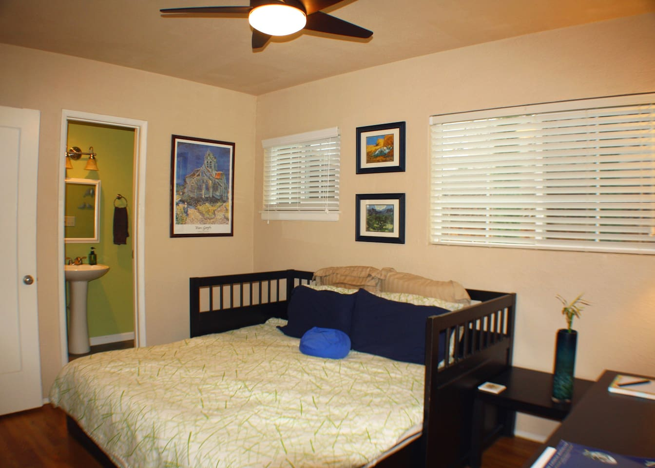 private bedroom with queen bed, desk, and attached bath