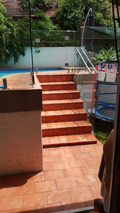 Stairs up to pool and deck area