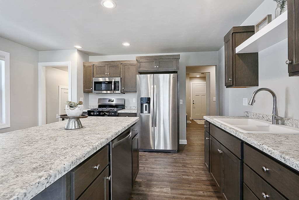 Kitchen Stocked with all essentials, outfitted with SS Appliances.