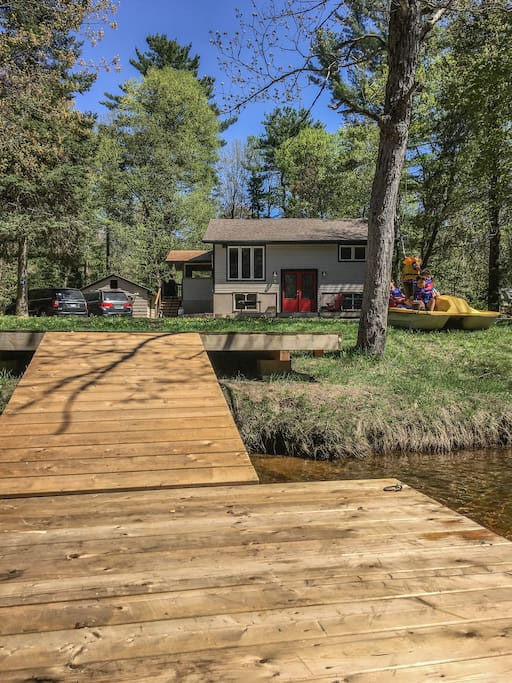 a view of the cottage from the dock