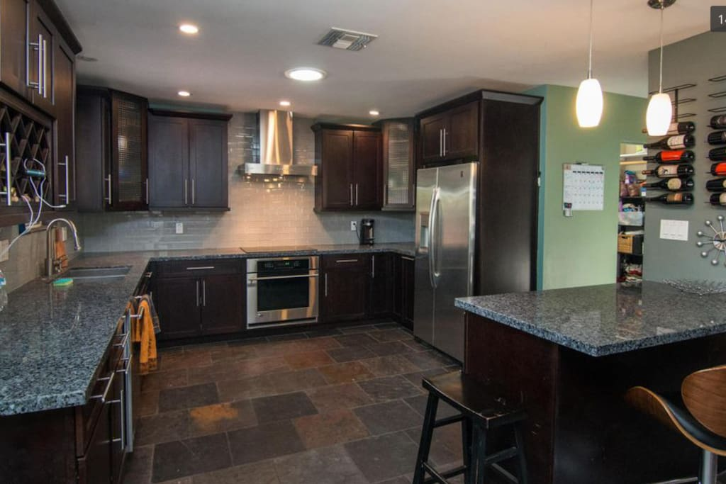 kitchen, laundry room with front loading washer and dryer