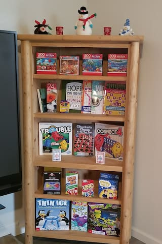 Puzzles, board games, card games, coloring book with crayons, reading material, word search, etc.