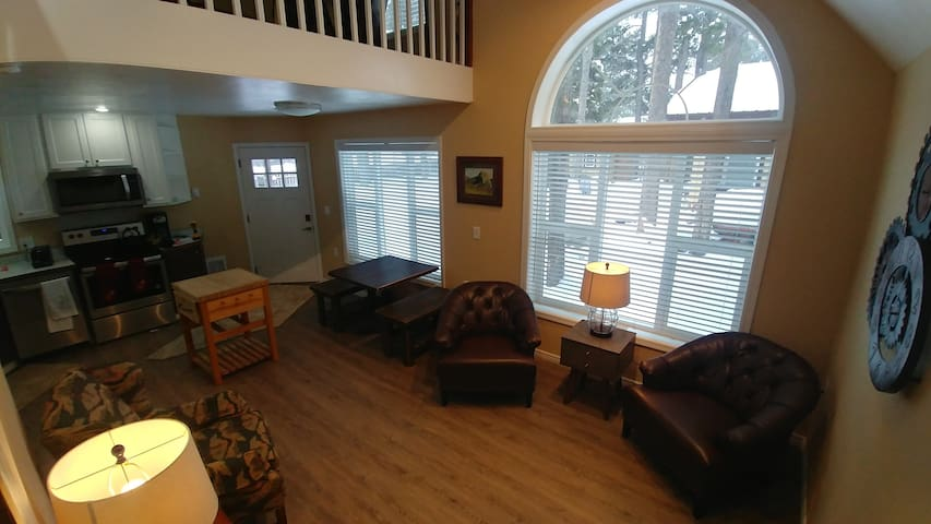 Here is a view from the stairs one can see how light it is and blinds that can be used for privacy.
