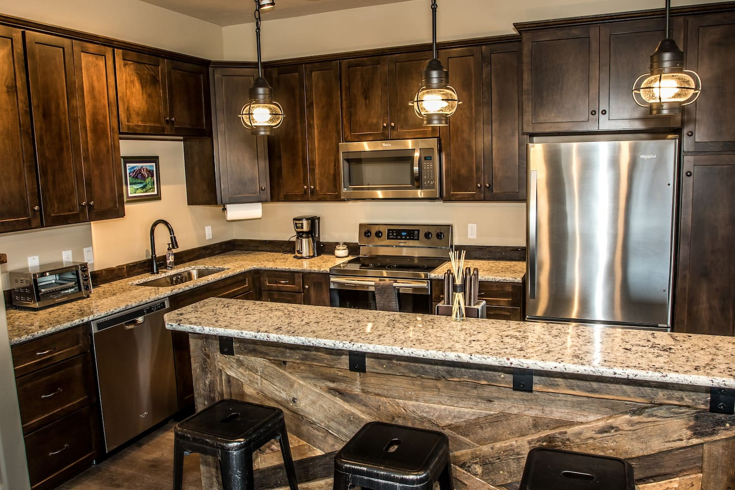 """Granite counter tops, historic barn wood finishes and high end appliances.  """"The pictures don't do this place justice! Way better than I could've imagined!!!""""***** Paige- September 2017"""