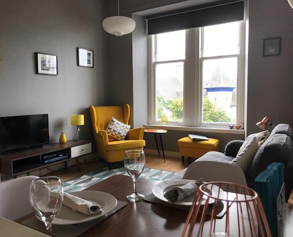 Flat above town centre with views and free parking