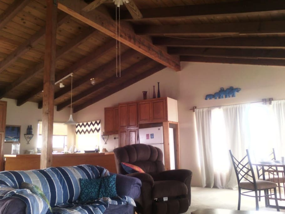 Spacious Great Room with dramatic open beam ceilings
