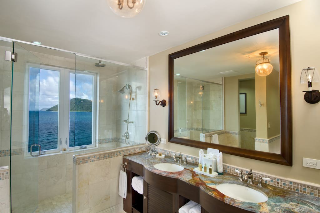 Lavish bathrooms with walk-in rain showers, soaking tubs, double-sink vanities, and private water closets.