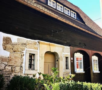 Experience the special atmosphere of a 300-year Umgebinde house with modern living comfort