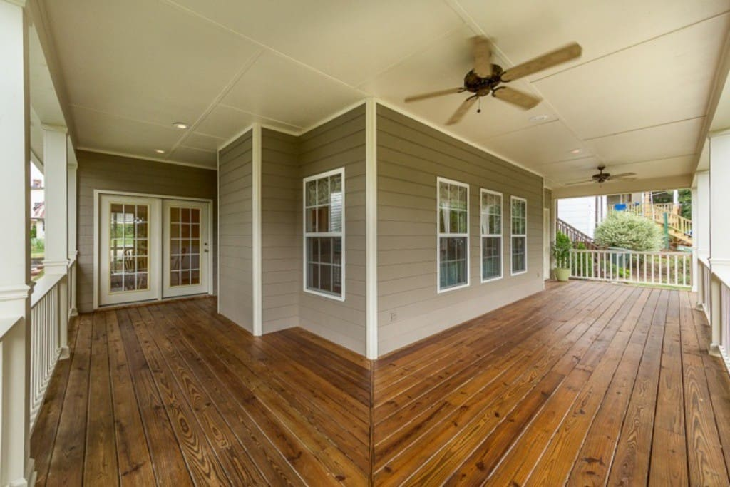 Relax on the porch swing while staying cool under the ceiling fans
