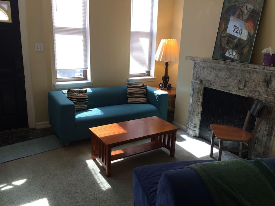 Front door opens to shared living room.