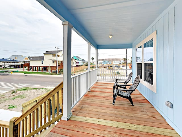 A shaded porch with seating for 2 offers the perfect spot for enjoying the gulf breezes.