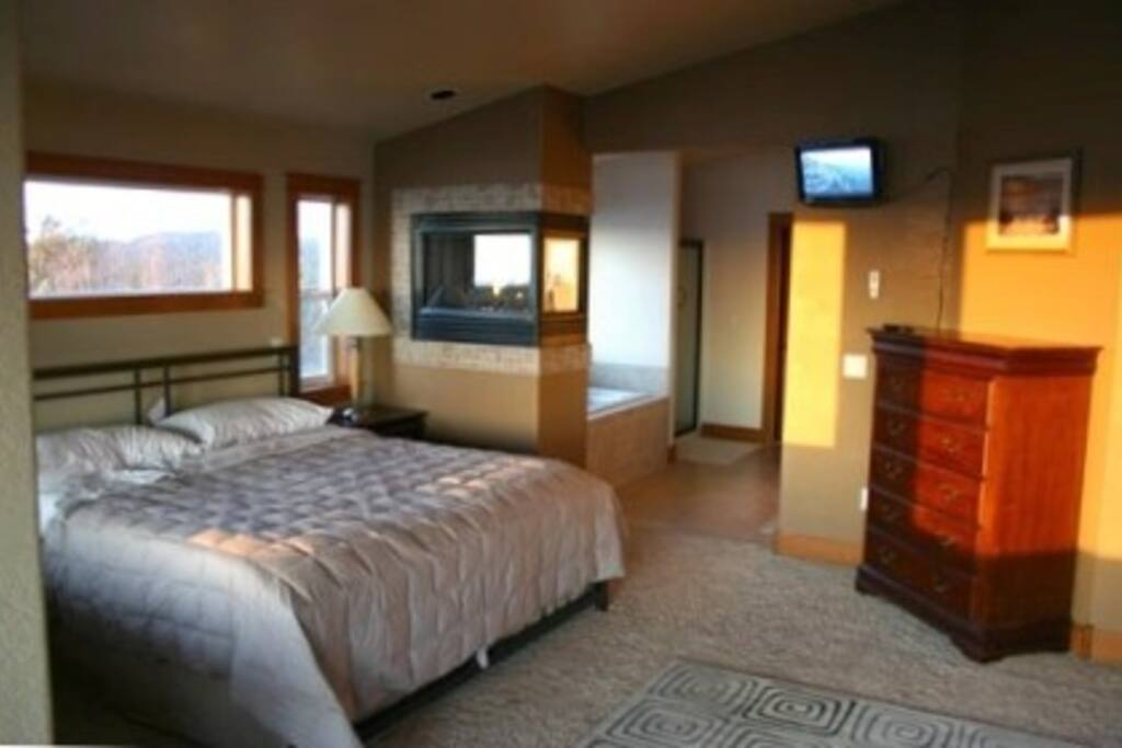 A view of your king bed and bath in the almost 800 sq. ft. Master Suite!