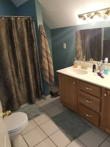 Shared bathroom with necessary bathing accommodations provided with room purchase (soap, shampoo, linens, etc.)