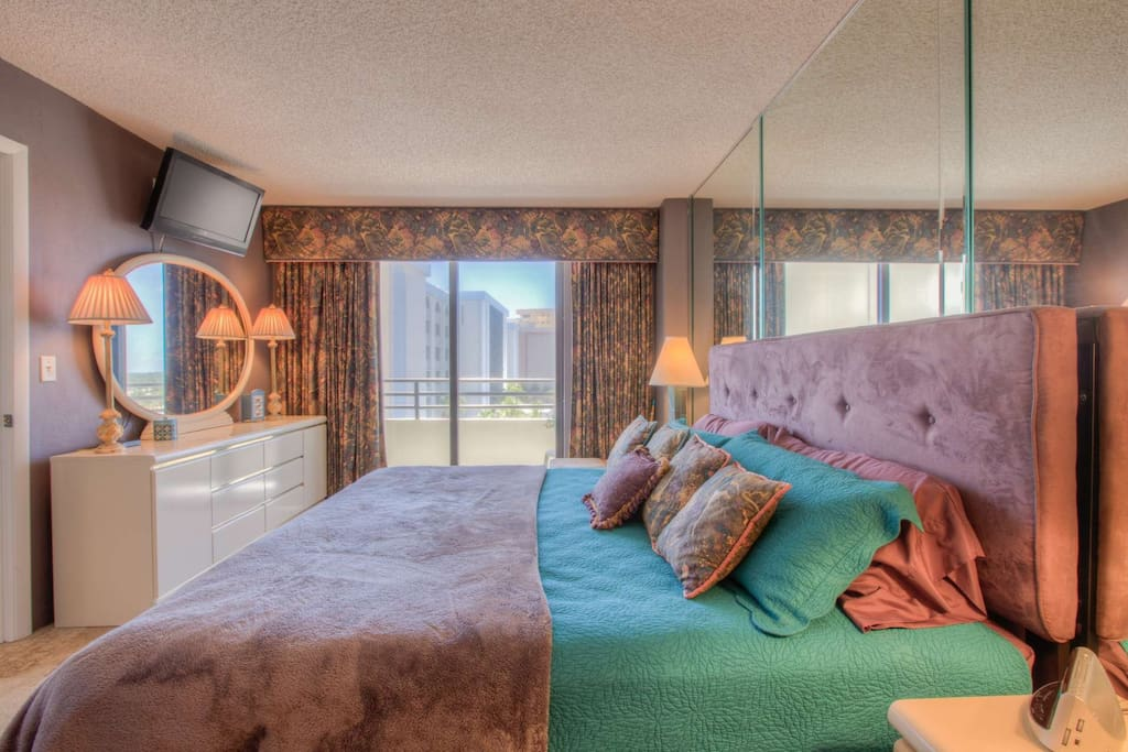 Master bedroom with flat screen TV and large private balcony with views of both the ocean & Intracoastal Waterways!