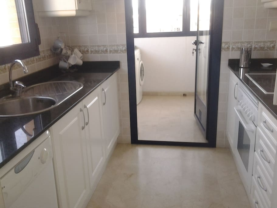 Well equipped kitchen leading to utility