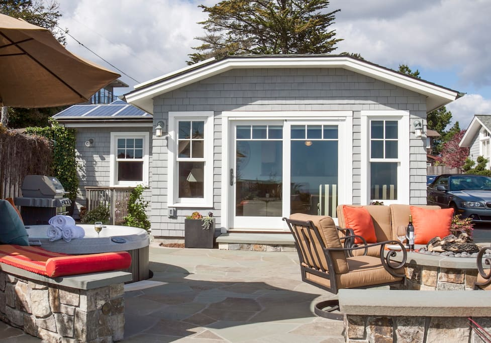 Cottage front with patio, fire pit, hot tub and BBQ