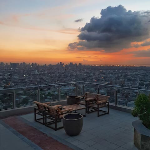 The unit is located in the taller South Tower, which has a roofdeck with panoramic views in all directions across Manila