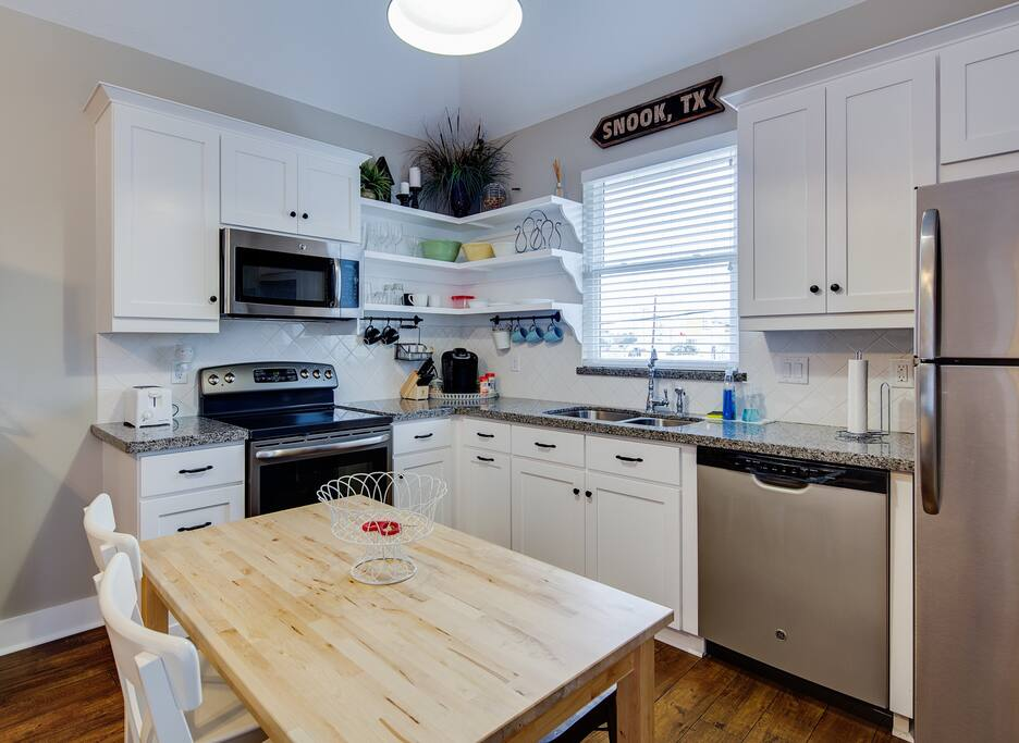Full kitchen with Granite Countertops, Stainless Steel appliances and kitchenware