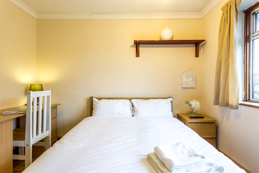 Room features plenty of storage and is light and airy.