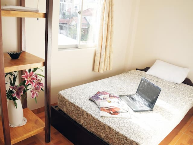 Single Bed Room (with Shared Bathroom)