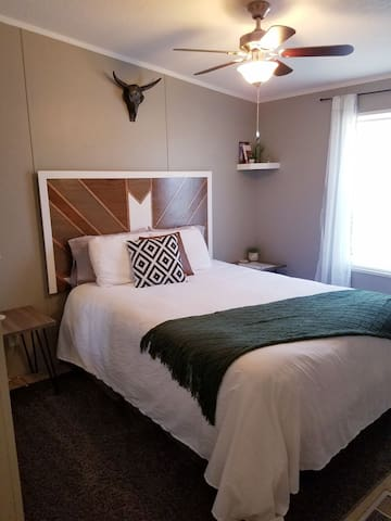 Guest room #1. Soft bed and bedding with down alternative comforter. Very cozy and comfortable room!