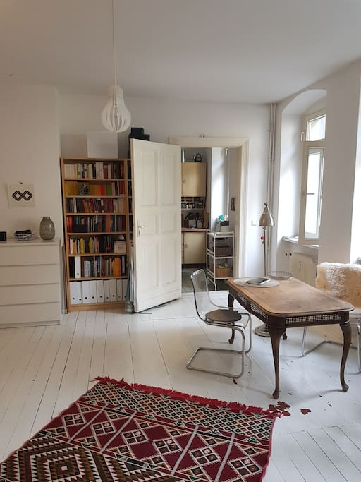Big room with white wooden floor
