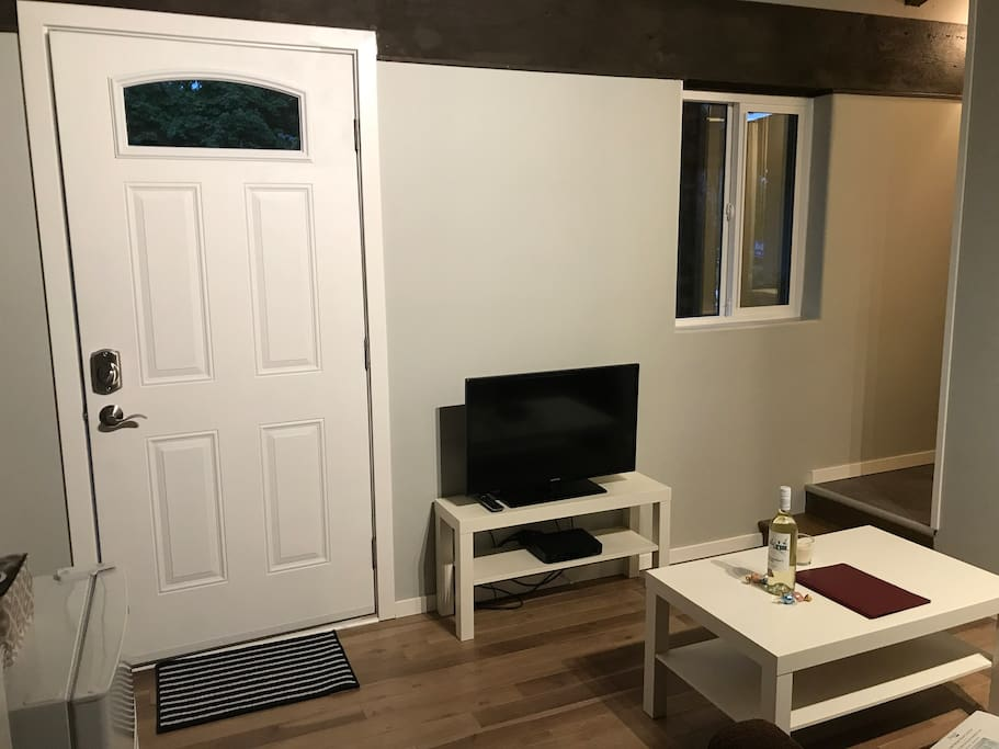 Living room and front entrance. Telus Optik TV.
