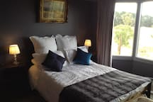The guest bedroom has a double bed with 1000 thread count cotton sheets, electric blanket, reading lamps, wardrobe and TV
