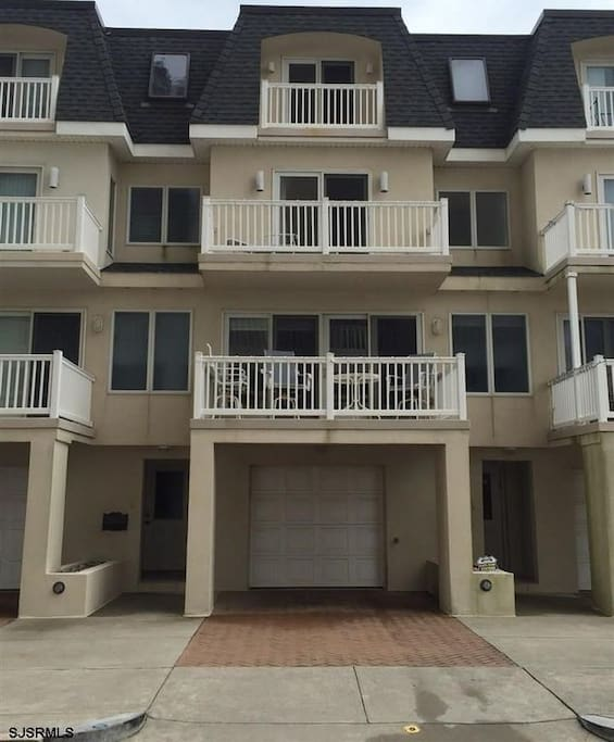 Beautiful town house with three sea view balconies. It has two car garage and an additional car parking space in the driveway.