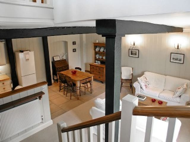 The living dining and kitchen areas of the cottage