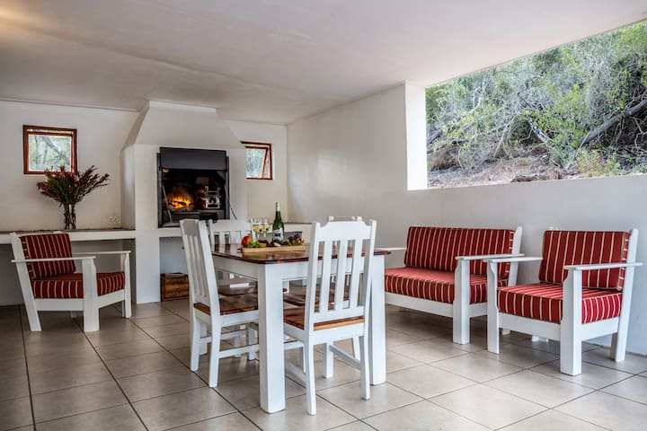 Spacious Covered BBQ facilities, stocked with firewood and with views of the pool and the mountains.