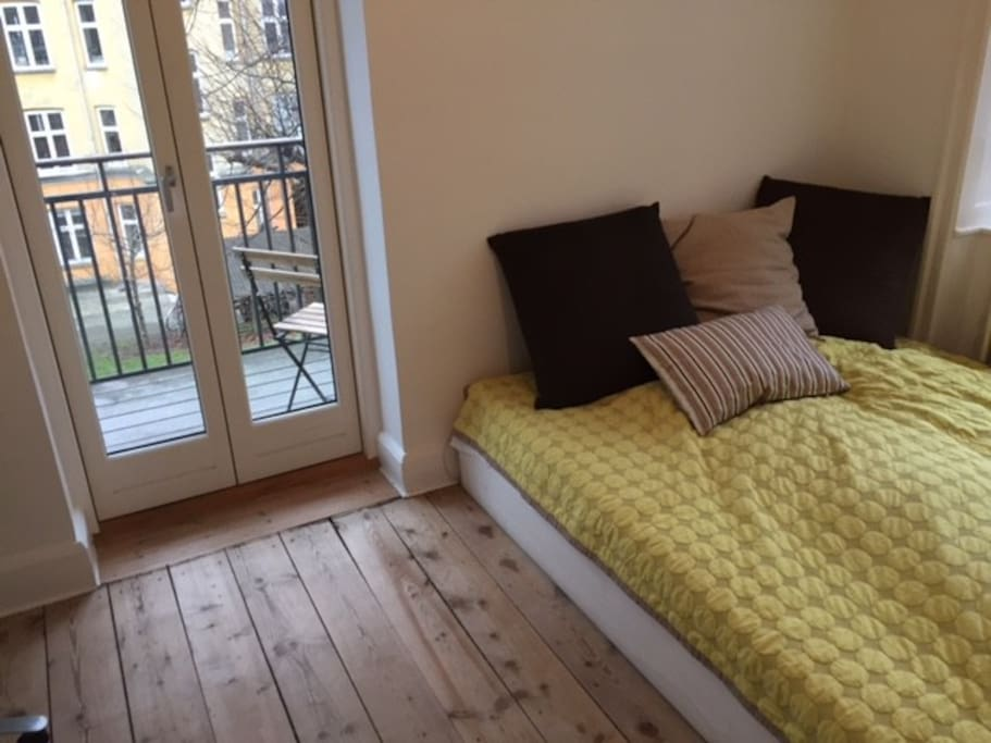 Bedroom with large comfortable double bed and access to balcony