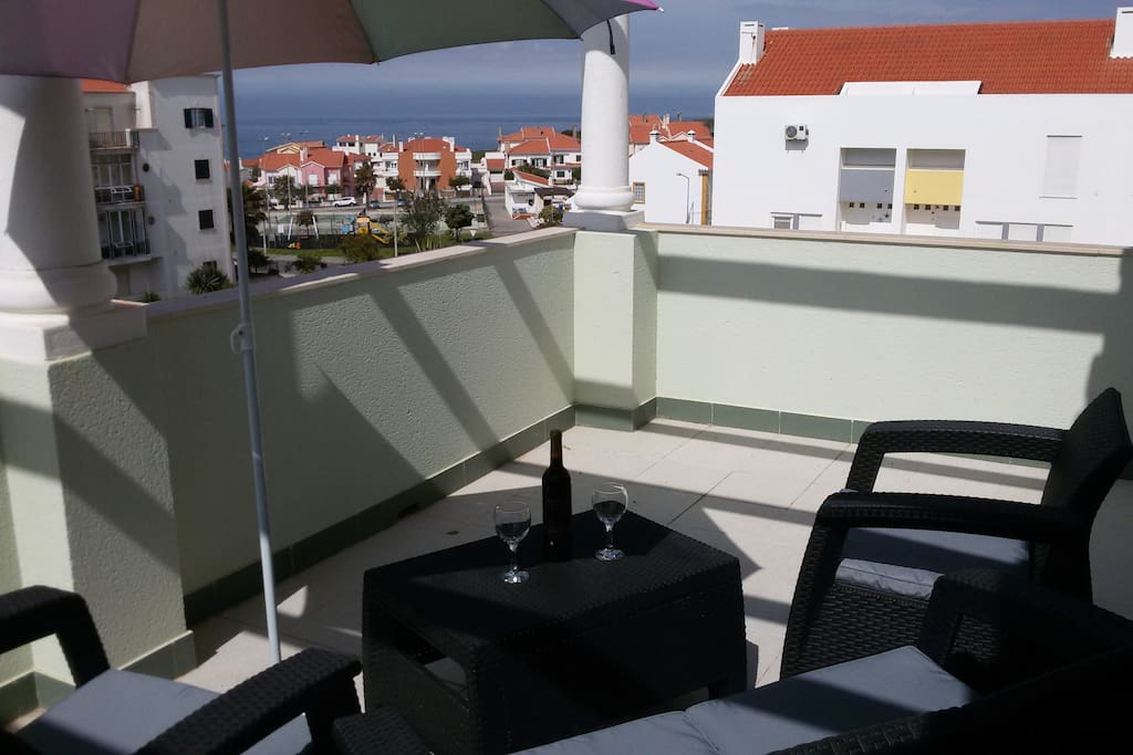 Terrace next to upstairs lounge area with ocean view