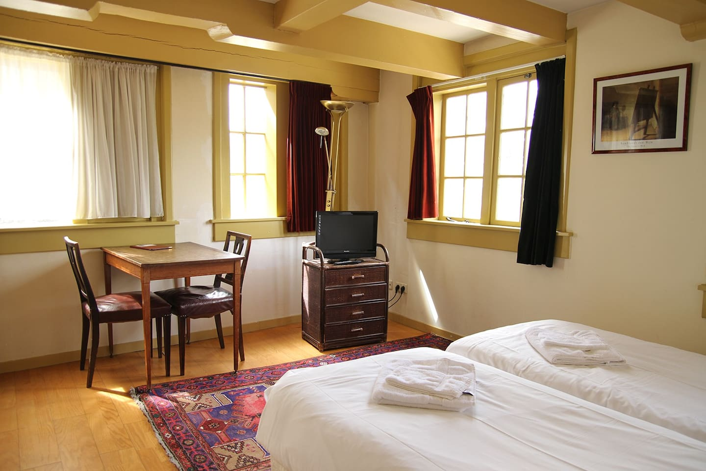The room has two comfy single beds.