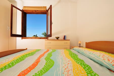 Casa colori a Cala Moresca - Ogliastra - Villa