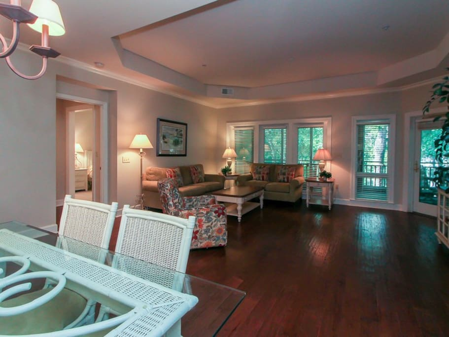Open Living Area at 8116 Wendover Dunes includes access to the large screened in porch