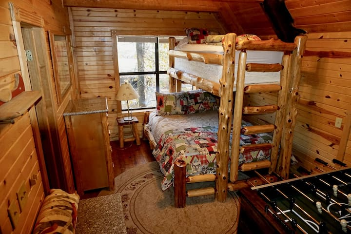 Upstairs Bedroom in the Loft has a Queen Bunk bed on bottom and Twin on Top. There is a Foosball Table and a Full Size Bathroom.